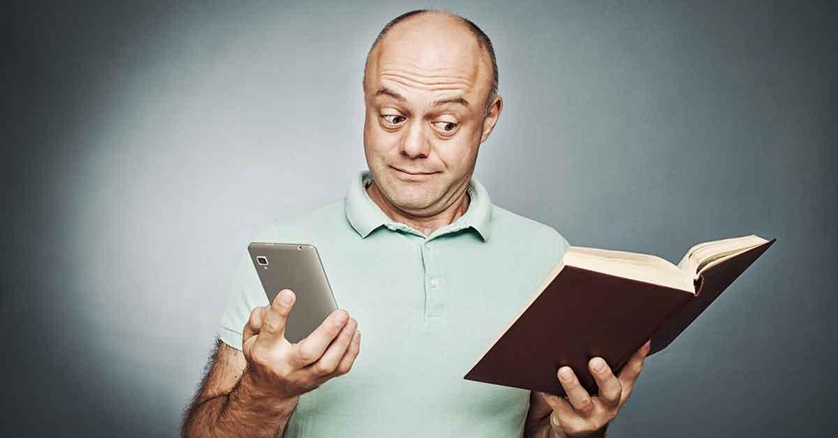 man looking at cheat sheet -funny