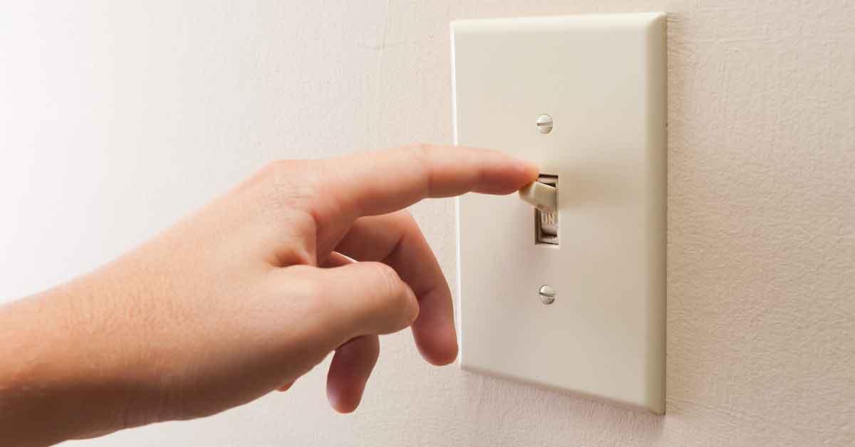 hand switching light switch